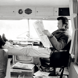 Clint Eastwood reading newspaper