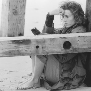 American actress Jane Fonda looking melancholy on the beach in Norfolk, England while working on Fred Zinnemann's drama 'Julia' in which she plays dramatist Lillian Hellman, 1977.