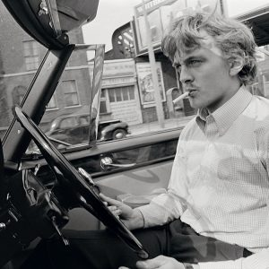 Actor David Hemmings drives a convertible car in London during the filming of Antonioni's classic movie 'Blow Up' in 1966.