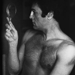 American actor Tony Curtis inspecting his make up while starring in Richard Fleischer's film 'The Boston Strangler', 1968.